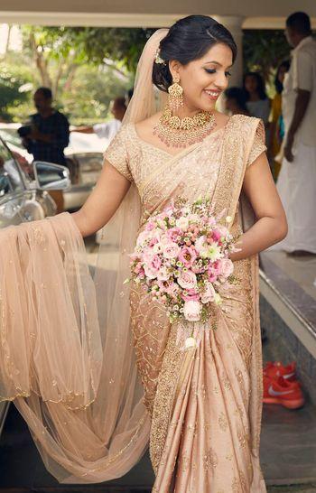A christian bride in gold saree