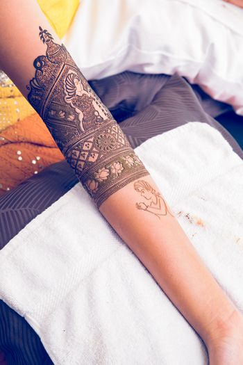 Intricate mehendi designs on arm