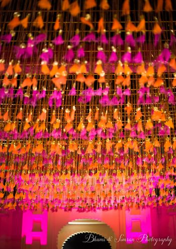 Photo of Orange and pink theme ceiling decor for mehendi