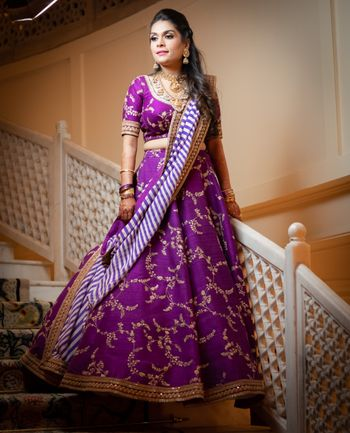 Photo of A bride in a purple lehenga for her cocktail