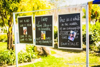 Photo of three chalboards with love quotes on them