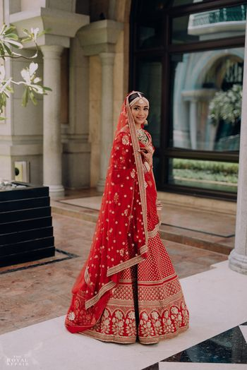 Photo of A bride in a red bridal lehenga