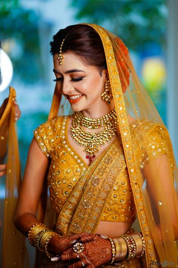 Photo of Glowing bride in orange lehenga shot