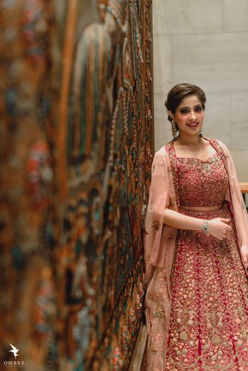 A bride to be in a shimmer lehenga for her engagement ceremony