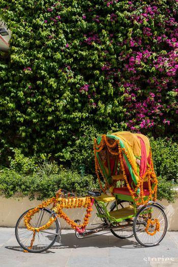 Photo of rickshaw prop on mehendi decor