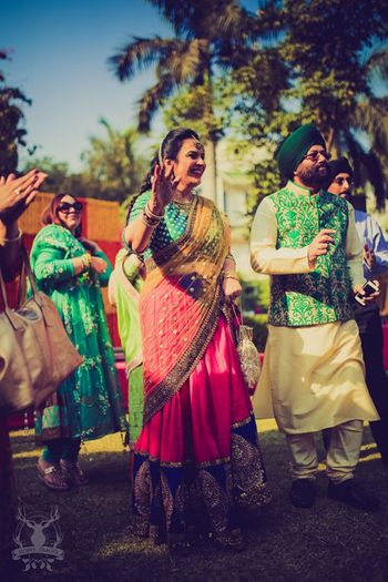 Photo of pink and green lehenga for brides or grooms mom