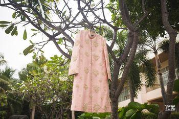 Photo of Light dusty pink sherwani on hanger