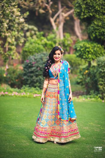Bright and happy mehendi lehenga