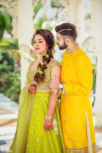 Photo of Lime green lehenga with floral braided hairstyle