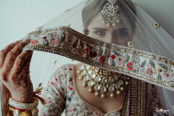 Photo of bride with embroidered dupatta border showing