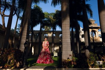 Beautiful bridal portrait of a bride in a red lehenga