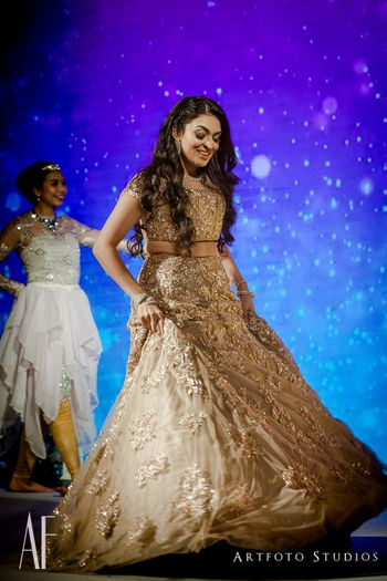 Bride dancing n gold embellished lehenga