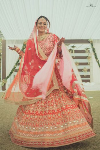 Red and orange bridal lehenga by Anita Dongre
