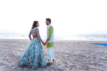 Photo of Pre wedding shoot on beach during engagement