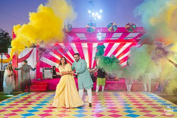 mehendi or sangeet idea with smoke bombs during couple dance