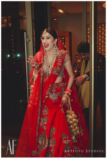 Bride in red bridal lehenga by Manish Malhotra