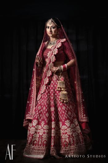 Photo of Royal bridal lehenga in maroon with scalloped edge