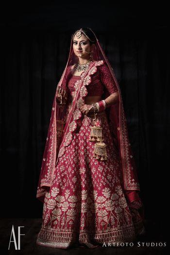 Photo of Royal bridal lehenga in maroon with scalloped edge