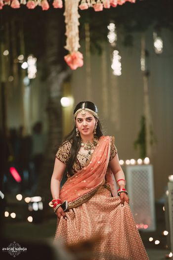 Photo of peach and bronze lehenga