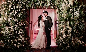 Photo of Engagement couple portrait with grand entrance decor