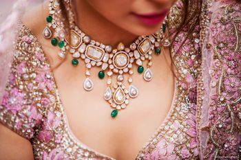 A gorgeous wedding day statement necklace worn by the bride