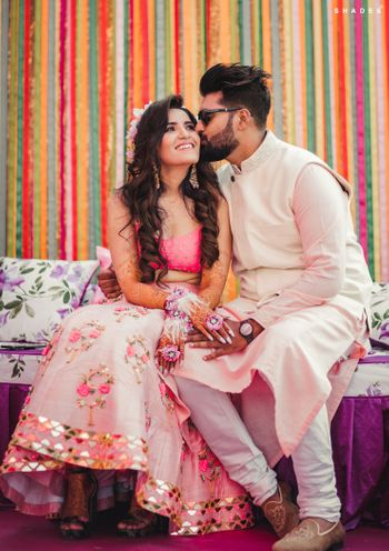 A color-coordinated couple on their mehendi ceremony