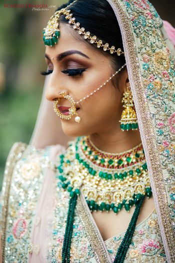 Photo of Bridal jewellery with jhumkis and green beads