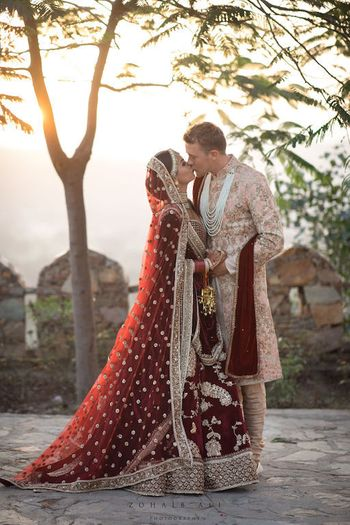 Photo of Sabyasachi bride and groom kissing