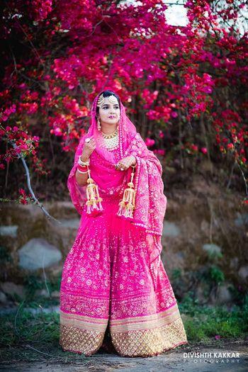 Fuschia pink bridal lehenga with threadwork