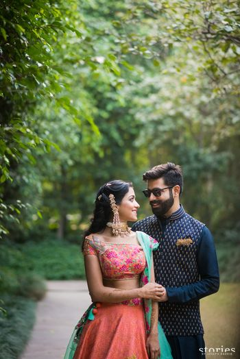 Photo of Mehendi bride and groom with contrasting outfits