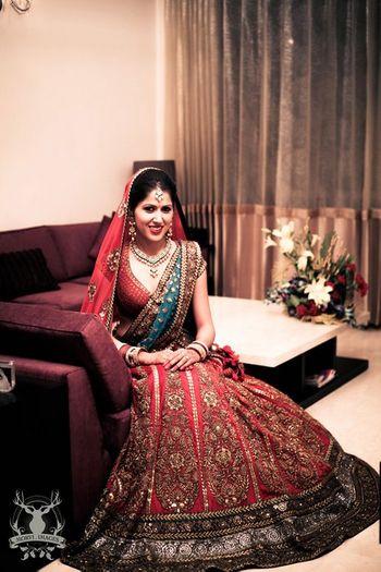 Photo of Sabyasachi bridal lehenga turquoise and red