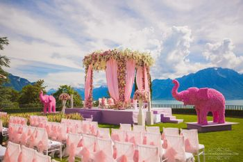 Photo of Light pink floral mandap with floral elephant