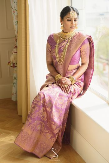 Photo of pretty unique bridal saree in light pink and gold