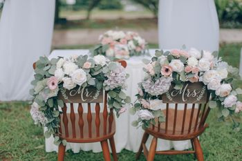 Floral bride and groom chairs for wedding day