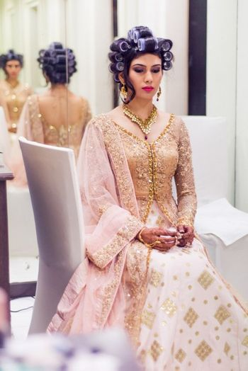 gold and white anarkali with blush pink dupatta for engagement event