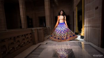 Twirling bride in purple lehenga on mehendi