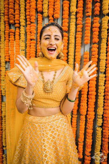Haldi bridal portrait in yellow lehenga