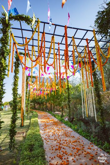 colourful mehendi decor idea with floral strings hanging