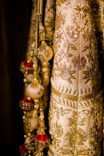 Gold and cream bridal lehenga with zardozi