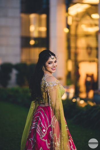 Photo of Happy bride shot with bride looking back