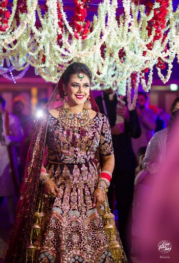 Bride in manish malhotra lehenga
