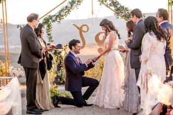 Bride and groom exchanging rings.