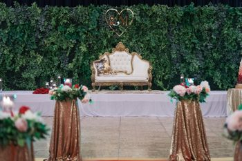 Simple yet stunning stage decor with a green backdrop