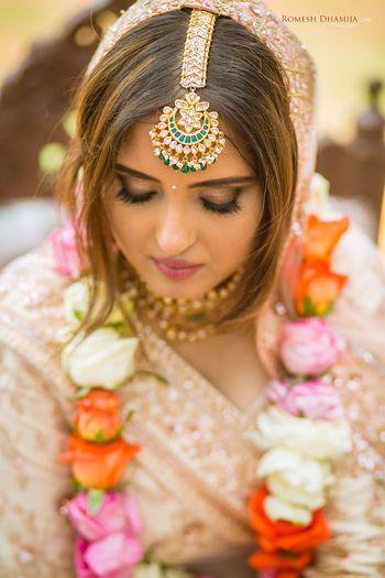 Simple bridal jewellery with maangtikka