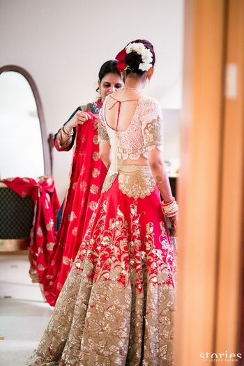 Photo of Red and pink lehenga by Anamika Khanna