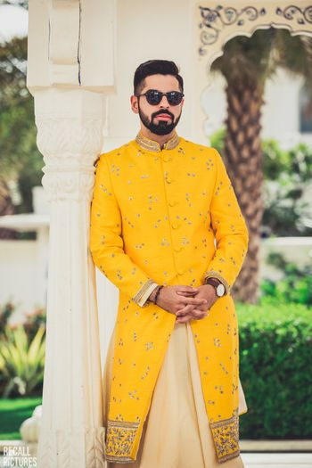 Photo of Offbeat mehendi groomwear in yellow colour