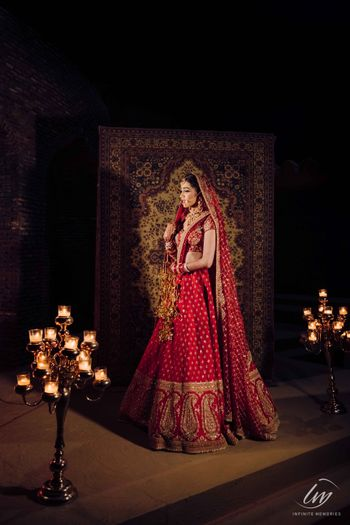 Photo of classic red bridal lehenga royal bridal photo
