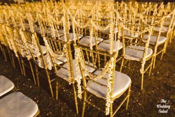 Photo of Gajra draped on wedding chairs