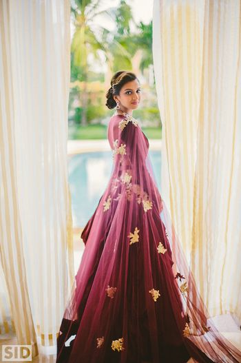 Wine colored gown by Jay Makhija