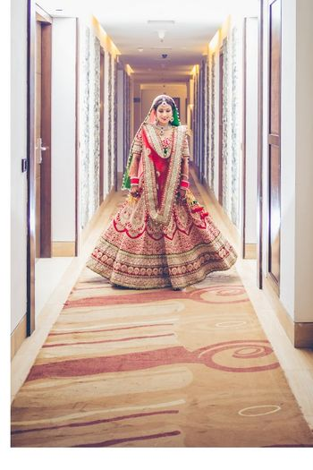 Photo of heavy red bridal lehenga